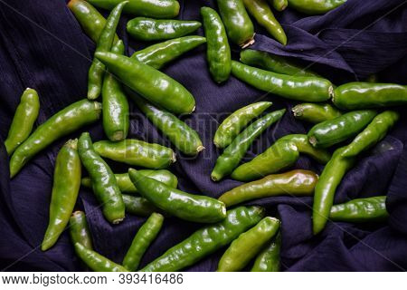 Picture Of Fresh And Hot Green Chillies With Black Background
