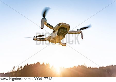 Graz, Austria: 02.01.2020 - Close Up Shoot Of A Dji Quadcopter Drone Mavic Mini 249g. Drone Flying A