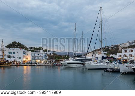 Chora, Ios Island, Greece- 19 September 2020: Boats And Sailing Ship Moored At The Harbor Wharf. Whi