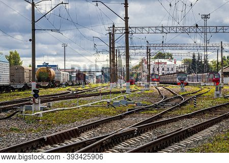 Russia, Kaluga - October 27, 2020: Railroad Tracks With Passenger Electric Train And Freight Trains.