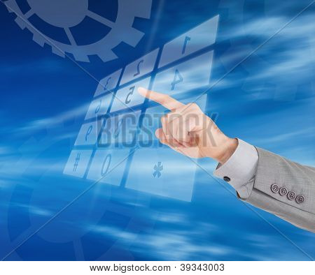 Businessman is dialling a number at a holographic number pad on blue digial background