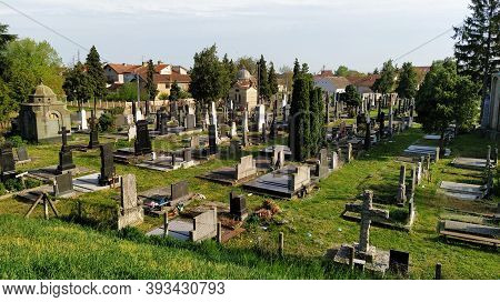 Sremska Mitrovica, Serbia, August 07, 2020. Cemetery, Monuments And Hills. Summertime And Green Gras