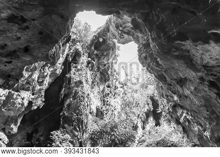 A Light Chimney Passing Through A Cave With Stalactites And Stalagmites At Tham Phraya Nakhon Cave,