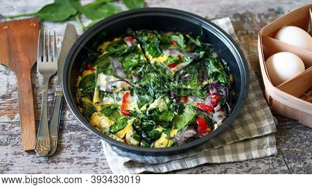 Healthy Homemade Omelet With Spinach And Vegetables. Spinach Omelet In A Pan. Cooking Healthy Food A