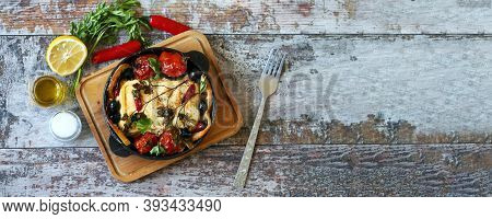 A Pan With Baked Feta, Spices And Vegetables. Keto Diet. Baked Feta Cheese. Healthy Food.