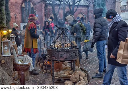 Latvia, Riga 01,01,2016 People Buy Food And Mulled Wine At The Christmas Market
