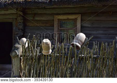 Old Crock On Picket Fence Of Farmstead