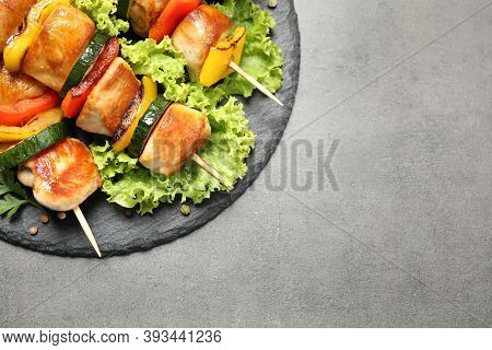 Delicious Chicken Shish Kebabs With Vegetables On Grey Table, Top View. Space For Text