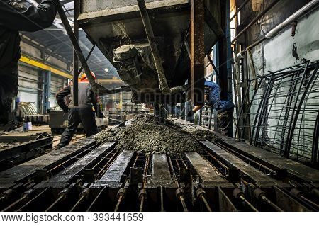 The Production Process Is The Creation Of Reinforced Concrete Pillars. An Industrial Worker At The P