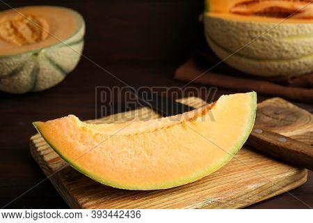 Slice Of Tasty Fresh Melon On Wooden Board, Closeup