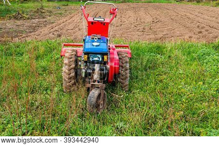 Farm Machinery Walk Behind Tractor In The Field.