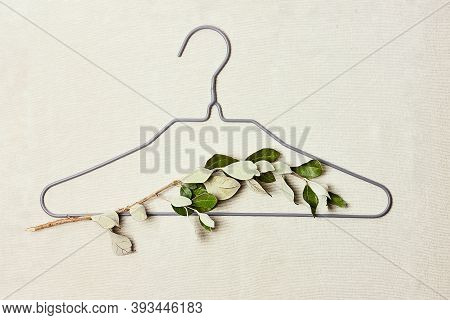 Iron Hanger With Sprig Of The Tree With Leaves On Linen Background. Eco-friendly, Chic, Cozy, Sustai