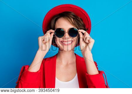 Close-up Portrait Of Pretty Cheerful Lady Wearing Trendy Look Outfit Touching Specs Isolated On Brig
