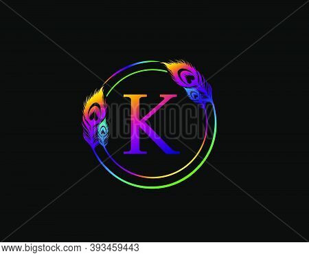 K Letter Decorated With Exotic Peacock Feather. Circle Badge With Peacock Feather.