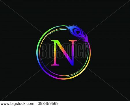 N Letter Decorated With Hologram Color Peacock Feather. Circle Badge With Peacock Feather.