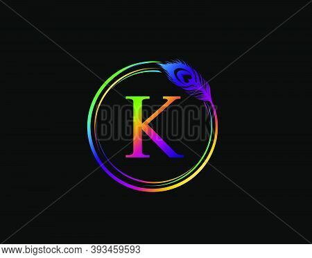 K Letter Decorated With Hologram Color Peacock Feather. Circle Badge With Peacock Feather.