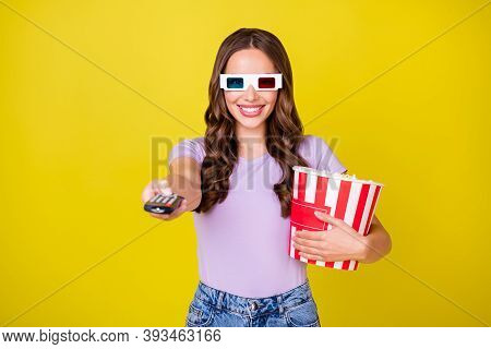 Portrait Of Lovely Cheerful Wavy-haired Girl Eating Corn Watching Tv Switching Channel Isolated Over