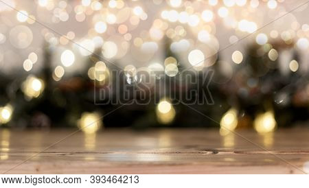 Empty Rustic Wooden Table With Blurred Christmas Lights At Background. Light Gold Bokeh Of Cafe Rest
