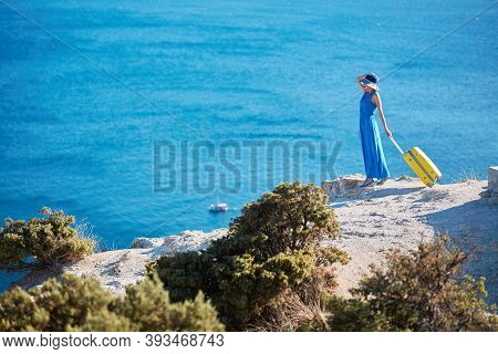 Travel Time And Vacation Abroad Idea, Copy Space. Pretty Lady On Mountain Top With Luggage. Sunny Ho