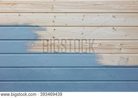 The Unfinished Blue Painted Wooden House Wall
