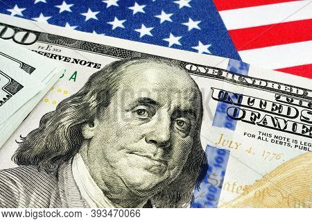 Usa Flag And Dollar Bills As Symbol Of Stimulus Check Of Cares Act.