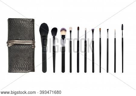 Leather Case For Cosmetics And Professional Makeup Brushes In Different Sizes. Set Of Makeup Brushes