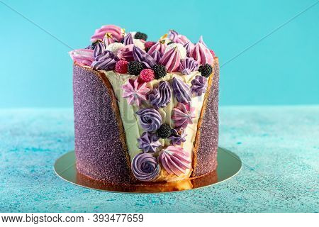 Beautiful Cake With Cheese Cream, Meringue And Marmalade Berries On A Light Blue Background. Concept