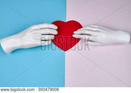 Concept Of Love And Devotion. Mannequin Hands And Heart.