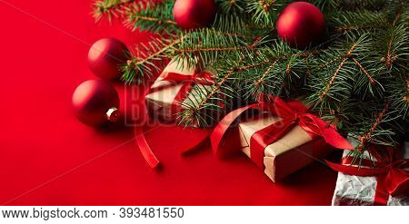 Christmas Background With A Christmas Tree And On A Red Background. Merry Christmas Card. Winter Hol