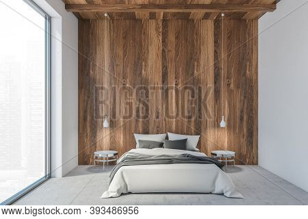 Bed In Wooden White Living Room With A Large Window, Sleeping Room With White Bed With Linen. Pendan