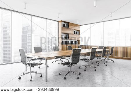 Office Meeting Room In Business Centre, Long Wooden Table With Black Chairs. Wooden And Grey Design
