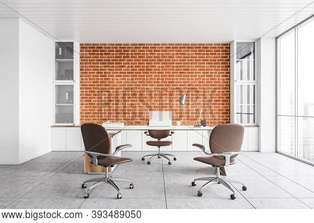 White Office Lobby Reception Room With Laptop On The Table And Three Leather Chairs, Brick Wall On B