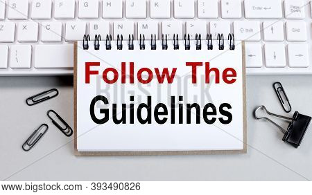 Follow The Guidelines, Text On White Paper On A Computer Keyboard On A Gray Background