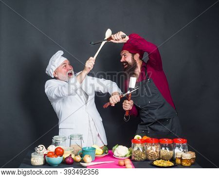 Kitchen Fight. Two Chefs On Kitchen. Kitchen. Cooking. Beared Chef Man. Delicious Food. Male Chef In