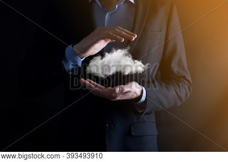 Businessman Hand Holding Cloud.cloud Computing Concept, Close Up Of Young Business Man With Cloud Ov