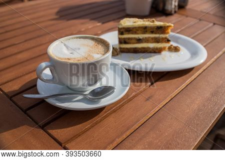 Carrots And Pumpkin Cake With Coffee Cream In A Cut On The Plate.delicious Sliced Carrot Cake.slice