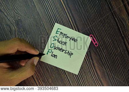 Esop - Employee Stock Ownership Plan Write On Sticky Note Isolated On Wooden Table. Business Concept