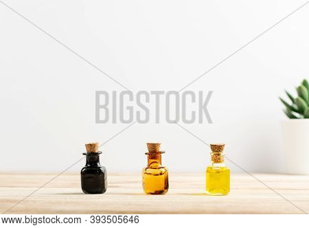 Essential Oil, Tincture Or Extract Mockup With Small Bottles