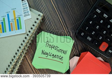 Professional Negligence Write On Sticky Note Isolated On Wooden Table. Business Concept