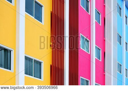 Windows Pattern And Balusters Lines On Colorful Multicolored Facade On Modern Style In Architecture
