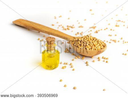 Mustard Seeds Essential Oil, Tincture Or Extract In Small Bottle
