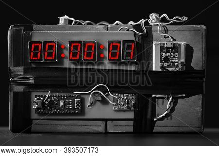 Terrorist Threat. Explosives With Detonator. Improvised Explosive Device. Bomb With A Red Timer On B