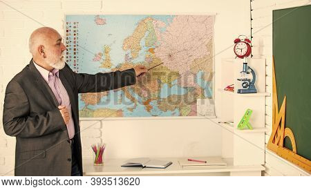 Geography Teacher Show Location On Map. Search Country And City On Map. Travel And Wanderlust Concep