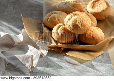 Kaiser, Or Vienna Buns In Bread Basket On Dark Background