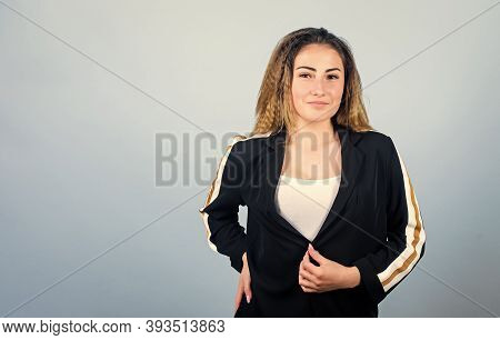 Voluminous Crimped Hairstyle. Trendy Crimped Hairstyle. Sport Chic. Woman Smiling Face Stylish Hairs