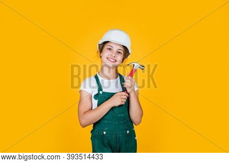 Cheerful Child Laborer Using Building Uniform And Hammer Tool, Labor Day
