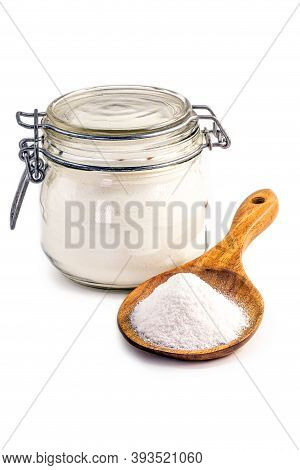 Glass Jar And Wooden Spoon With Baking Soda On Isolated White Background, Chemical Compound In Cryst