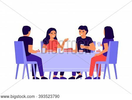 Group Of Young People Are Sitting Together At Table, Talking And Eating. Happy Friends Celebrate Hol