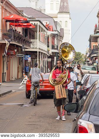 New Orleans, La - February 16: French Quarter Street Musicians Walking To Work On February 16,2014 I