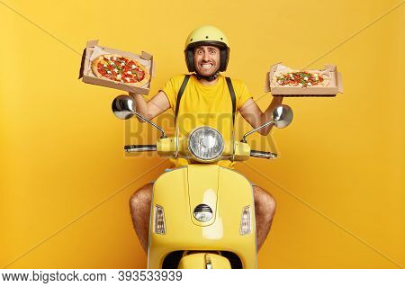 Photo Of Busy Food Courier Drives Fast Motorbike, Carries Two Carton Boxes With Delicious Pizza, Wea